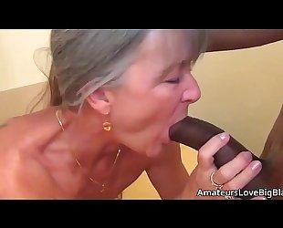 Grey haired granny enjoys large dark 10-Pounder