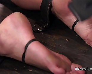 Busty golden-haired in device slavery feet tormented
