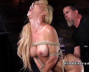 Hogtied blond hanged in rope servitude
