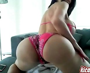 Brunette with massive mambos disrobes & fingers herself