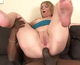Horny mom with natural breasts fucks her black lover on the couch