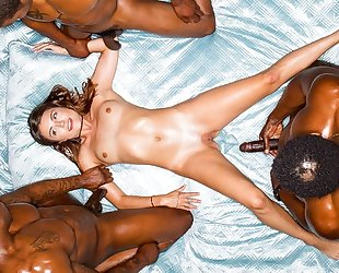 Petite babe gets rewarded with three massive black dicks