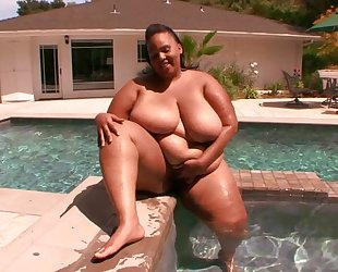 Fat ebony with huge melons takes rock hard cock in her snatch