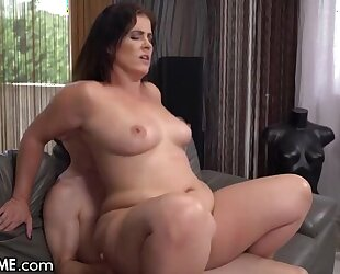 Slightly chubby MILF with natural boobs fucks young boy